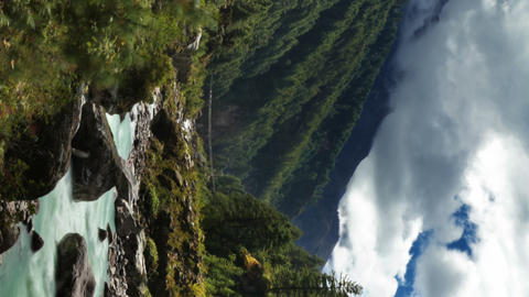 Vertical shot of Time-lapse of a river and a trail in a Himalayan valley Footage