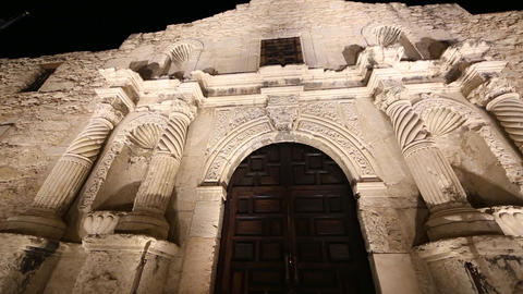 Up close panning view of the Alamo at night Footage