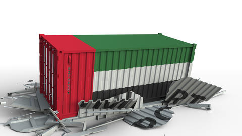 Cargo container with flag of the UAE breaks container with IMPORT text Live Action