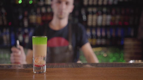 Close-up of a cocktail standing at a bar counter in a bar or restaurant against Footage