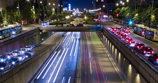 Double Cinemagraph of night scene of urban traffic.Time Lapse - Trail effect - Long exposure - 4K Footage