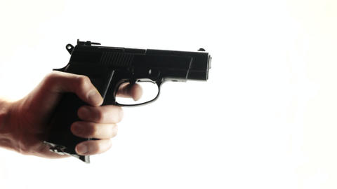 Hand with the gun, pressing trigger Live Action