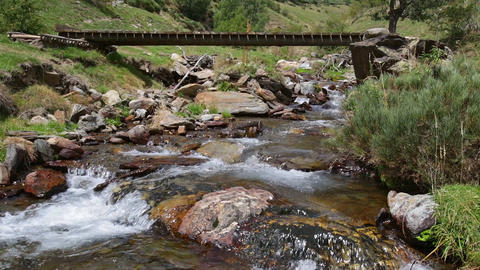 Mountain river with old footbridge.Time Lapse Live Action