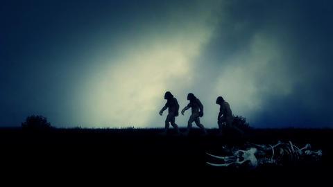 Few Cavemen Walking in Empty an Field Live Action