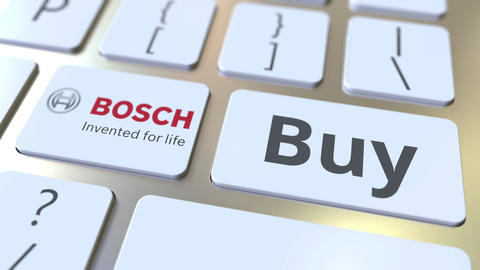 BOSCH company logo and Buy text on the keys of the computer keyboard, editorial Live Action