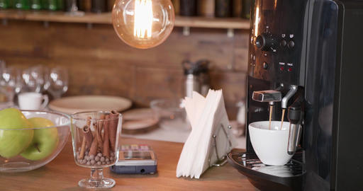 Coffee machine in a bar preparing a cup of good old black espresso Archivo