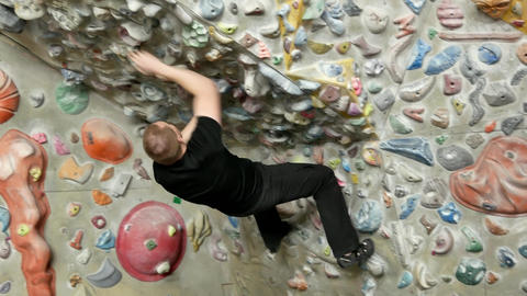 Man is climbing on the wall indoors Stock Video Footage