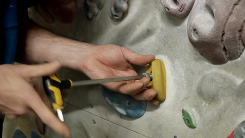 man screws handhold Footage
