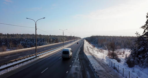 Aerial view of a highway road with traffic cars and trucks on the road in winter Live Action