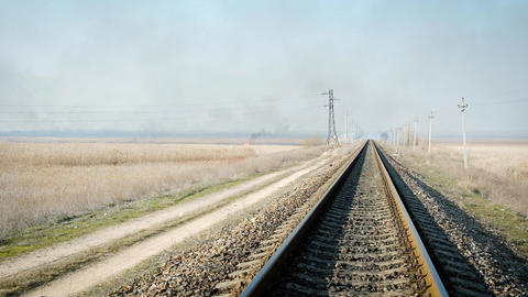 distant view of the iron rails for the train in the steppe Archivo
