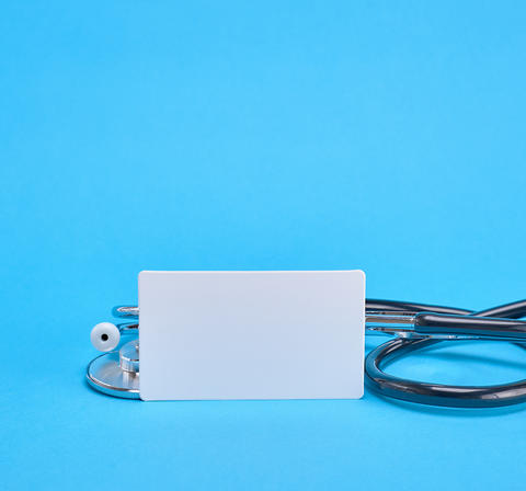 medical stethoscope and empty paper business card Fotografía