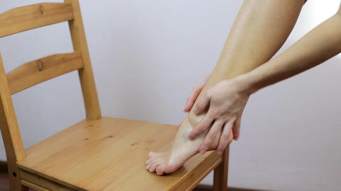 The girl does a foot massage after the depilation procedure Footage