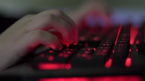 Boy Using Gaming Computer Keyboard Rack Focus Footage