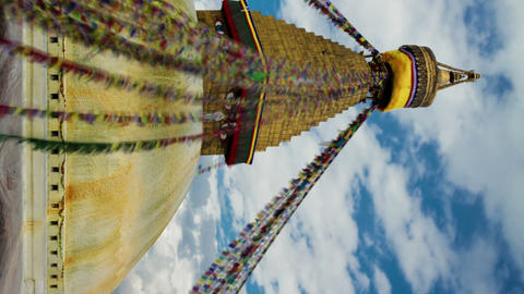 Vertical shot of Time-lapse of the top of Boudhanath Stupa in Boudha, Nepal Footage