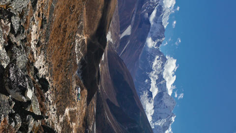 Vertical shot of Time-lapse of clouds passing over a Himalayan valley Footage