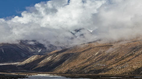 Panning shot of Time-lapse of the valley floor in the Himalaya in Nepal Footage