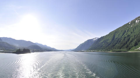 Traveling view of the ocean surrounded by mountains at the Inside Passage in Ala Footage
