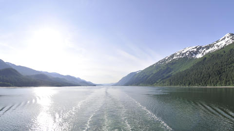Traveling time lapse view of the Inside Passage from behind a cruise ship in Ala Footage