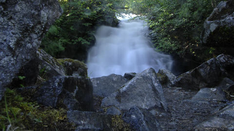 Low angle stationary time lapse of a waterfall in Alaska Footage