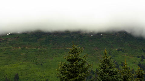 Time-lapse of cloud movement over a green hillside near Seward, Alaska Footage