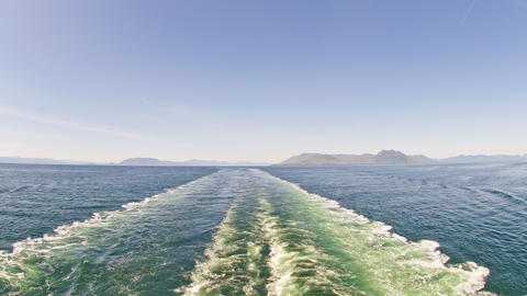 Time-lapse from the back of a cruise ship entering a channel in Alaska Footage