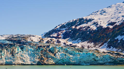 View of a big ice glacier and snow covered mountains in Glacier Bay Footage