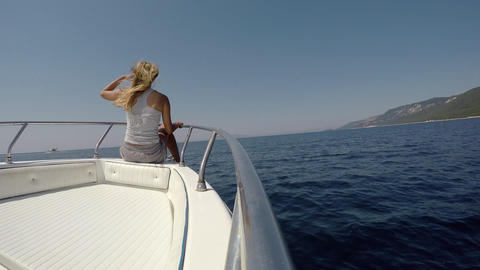 Young Woman Enjoying The Boat Ride While Sitting On A Bow stock footage