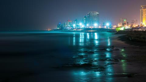 Night into day above a coastal Israeli city Footage