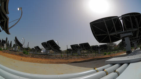 Time-lapse shot behind an array of solar collectors tracking the movement of the Footage