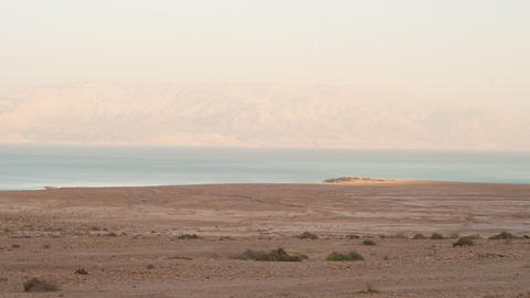 Haze clears during sunset to reveal distant hills across Sea of Galilee Footage
