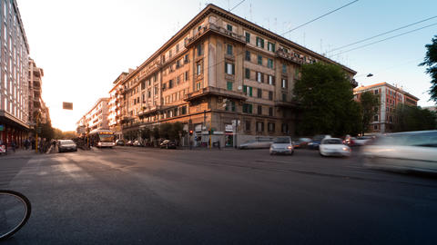 Time-lapse of busy traffic on a street corner in Rome, Italy Footage
