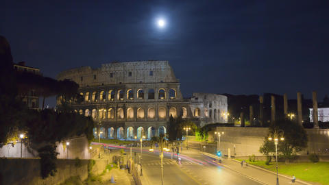 Moonlit time-lapse of the Colosseum and street traffic Footage