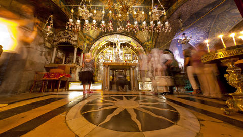 Tracking footage of pilgrims at an altar in the Church of the Holy Sepulchre Footage