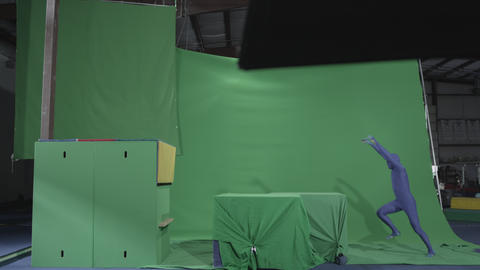 Preformer does parkour moves on chroma key objects Footage