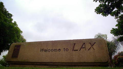 "Plane flies over ""Welcome to LAX"" sign Footage"