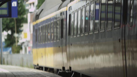 Static shot of train closing its doors and leaving the train station in Amsterda Footage