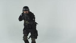 Shot of swat entering at left pointing an assault rifle. Shot in slow motion aga Footage