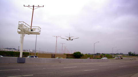 Low-angle shot of airplane arriving at LAX Footage