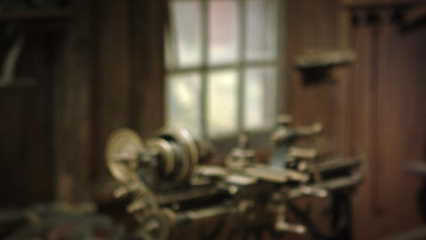 Racking-focus footage of a strange, old-looking machine Footage