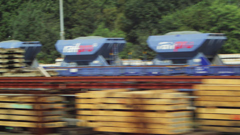 Tracking shot of containers and pallets alongside a road in Amsterdam Footage