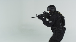 Shot of swat entering right screen with assault rifle. Shot in slow motion again Footage