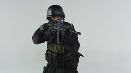 Shot of swat entering at left holding an assault rifle. Shot in slow motion agai Footage
