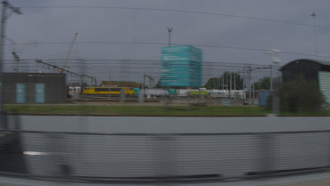 Shot of the train terminal taken from a moving train Footage