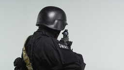 Back shot of swat soldier with an assault rifle ready. Shot in slow motion again Footage