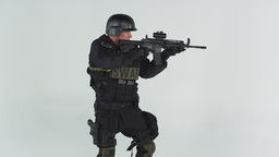 Shot of soldier raising his gun to firing position. Shot in slow motion against  Footage