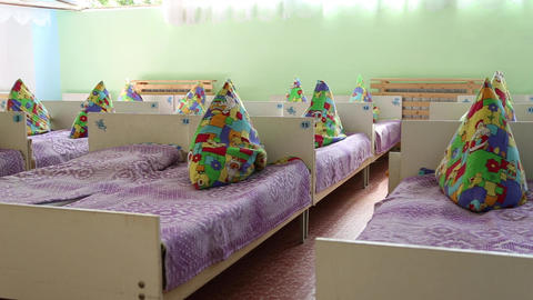 Beds with pillows in kindergarten Live Action