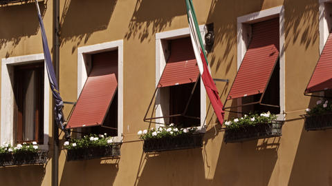 Windows and flags on side of building, slow motion, Venice Footage
