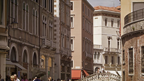 VENICE, ITALY - May 2: Crowd stroll the streets by the Ponte Tron bridge on May  Footage