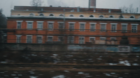 Looking at dull autumn city from moving train, Russia Footage
