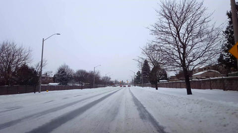 Driving Bumpy Snowy Street in Day. Driver Point of View POV Winter Driving While Snowing in Daytime Live Action
